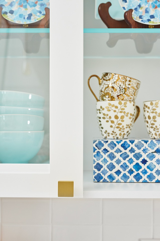 gold dishes, blue and white kitchen