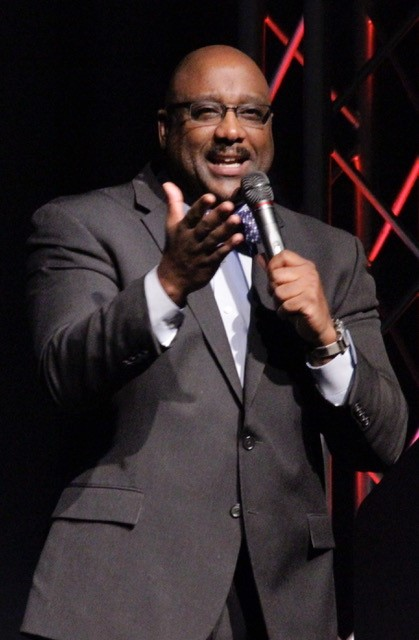 Dwayne Gill Michigan Comedian in a suit