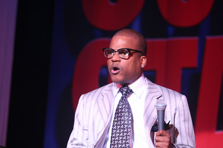 Ralph Harris wearing glasses on stage
