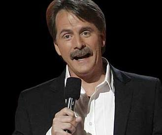 Jeff Foxworthy holds a microphone